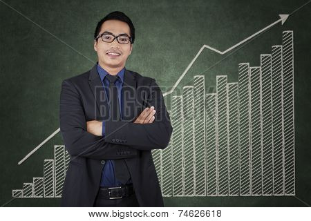 Confident Entrepreneur With Business Growth Chart