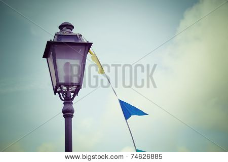 Lamppost And Flags