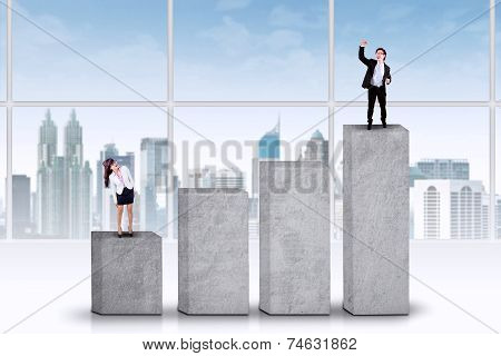 Two Businesspeople Standing On Bars
