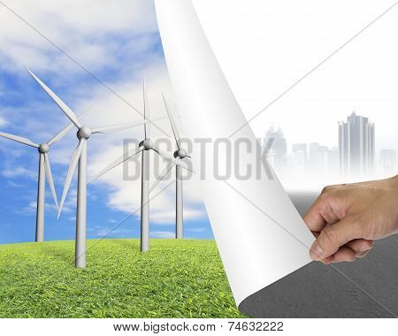 Hand Turning Gray Cityscape Page Revealing Group Of Wind Turbines