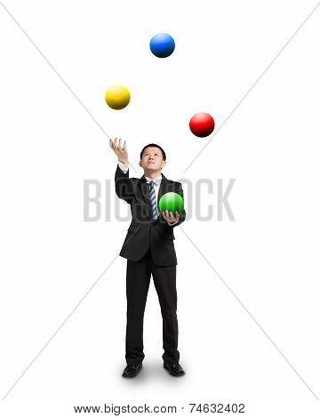 Black Suit Businessman Juggling Colorful Balls