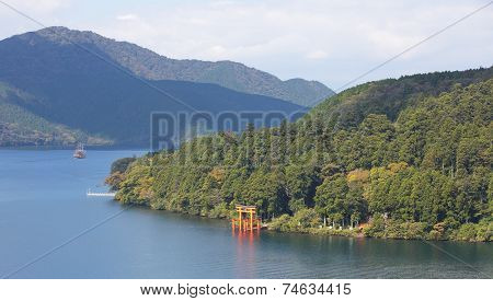 View of Lake Ashi and traditional Japanese gate