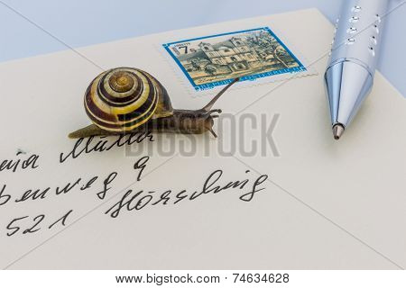 a snail on a letter. symbol photo for slow breifzustellung. smail