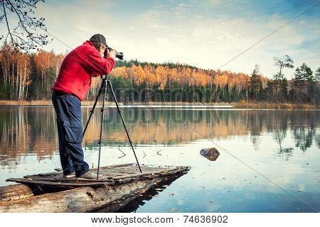Man Photographer With Camera On A Pier