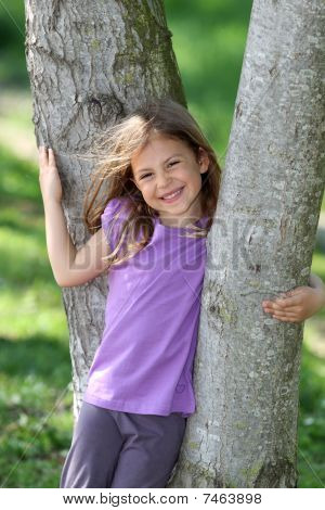 Girl resting on tree