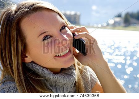 Cute Girl On The Phone In The Mountain