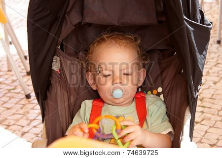 Toddler Sitting In His Pushchair