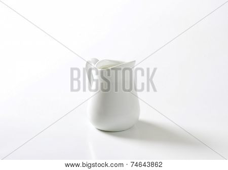 ceramic pitcher with liter of organic milk