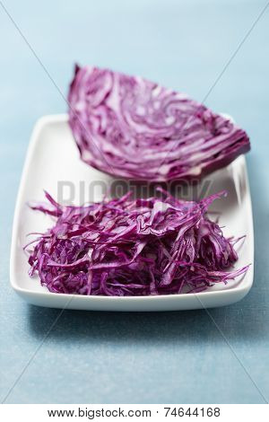 Shredded red cabbage on white plate