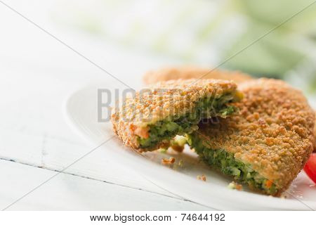 Spinach croquettes prepared from dough made of spinach, cheese and spices, all wrapped in bread crumbs