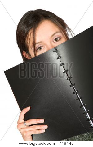 Beautiful Teen Peeping Over Notebook