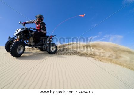 Sand Spray From Atv In The Dunes