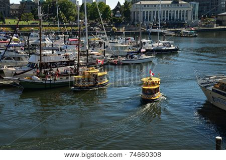 VICTORIA WATERFRONT JULY 15: View of  a water taxi on July 15, 2014 at Victoria Waterfront
