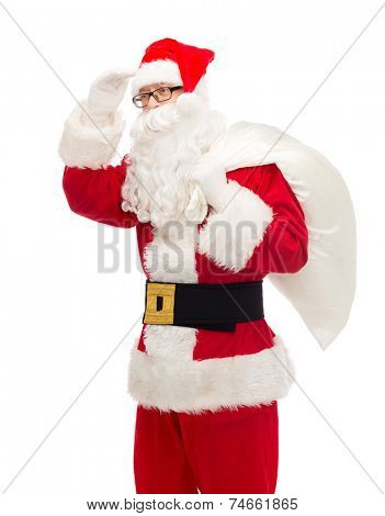 christmas, holidays and people concept - man in costume of santa claus with bag looking far away