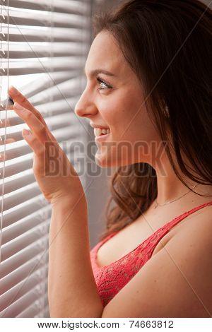 Girl Near Venetian Blinds In The Morning