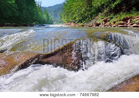Waterfall On The River In The Mountains