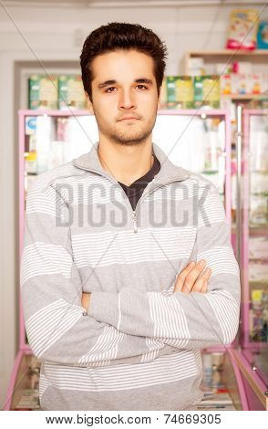 Customer In Front Of A Pharmacy Table