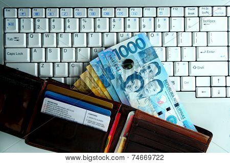 Money on a laptop computer