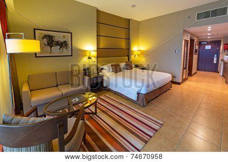 ABU DHABI, UAE - 25 MARCH 2014: Luxury bedroom of Khalidiya Palace by Rotana, United Arab Emirates. Rotana Hotel Management Corporation has 85 properties in 26 cities around Middle East and Africa.