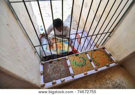 Bagan, Myanmar - October 9, 2013: Artist Painting A Pictures At Ananda Temple