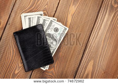 Money cash wallet on wooden table with copy space