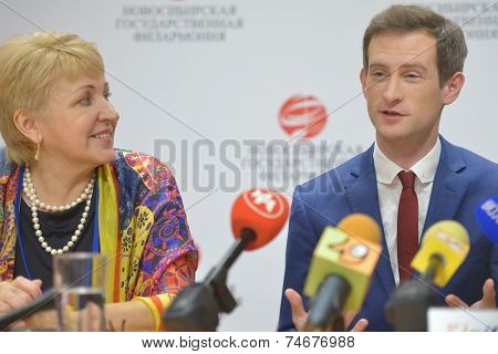 NOVOSIBIRSK, RUSSIA - OCTOBER 23, 2014: Anthony Strong on the press conference in honor of opening Sib Jazz Fest. Left side of him is the General director of  the Novosibirsk Philharmonic T. Ludmilina