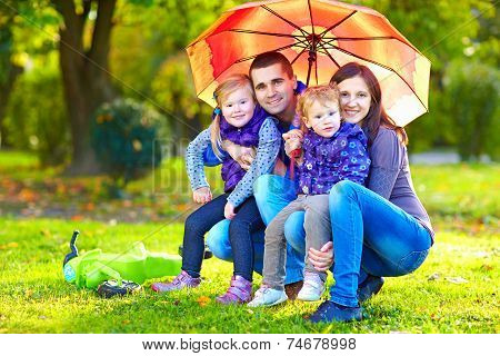 Portrait Of Happy Family In Autumn Park