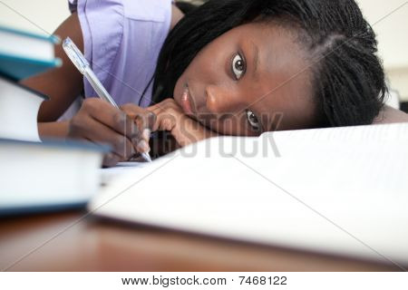 Tired Young Woman Studying