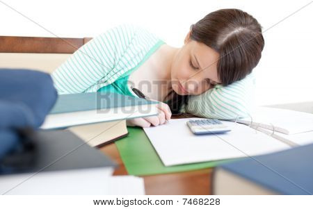 Young Tired Woman Studying On A Table