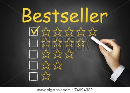 Hand Writing Bestseller On Black Chalkboard