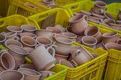 pic of handicrafts  - Rustic handmade ceramic clay brown terracotta cups souvenirs at street handicraft market in gafsaTunisia  - JPG