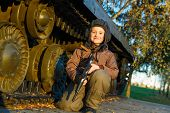 stock photo of panzer  - Portrait of young boy with gun playing near by panzer - JPG
