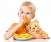 image of mating bears  - Portrait of a little boy with his teddy bear and oranges - JPG