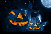 picture of creepy  - Scary glowing blue pumpkin decoration with creepy spiders - JPG