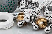 stock photo of plumbing  - plumbing and tools on a light background  - JPG