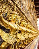 pic of garuda  - Garuda statue on the wall in temple - JPG