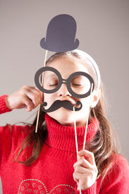 foto of girlie  - little girlie plays serious professor or scientist with carton hat - JPG