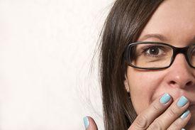 image of shot glasses  - Mod aged woman in glasses surprised studio shot - JPG