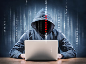 foto of spyware  - picture of an hacker on a laptop - JPG