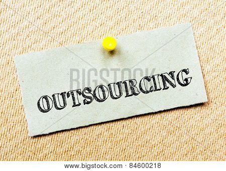 Recycled Paper Note Pinned On Cork Board. Outsourcing Message. Concept Image