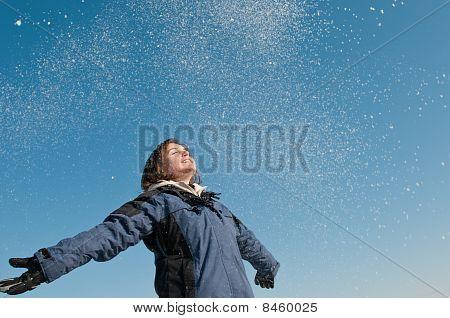 Enjoying Winter - Woman Throwing Snow