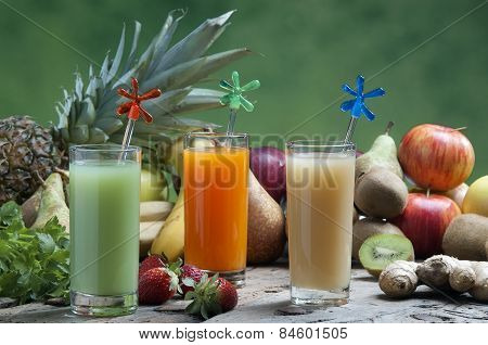 Juices Of Mixed Fruit On A Wooden Board