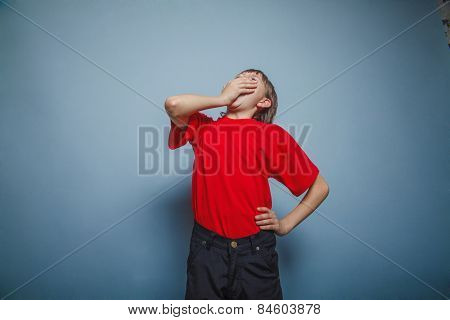 Boy, teenager, twelve years in the red shirt, closed her mouth,