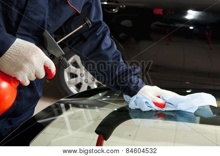 Close Up Of Mechanic Working In Auto Repair