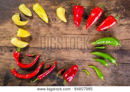 colorful peppers on wooden table