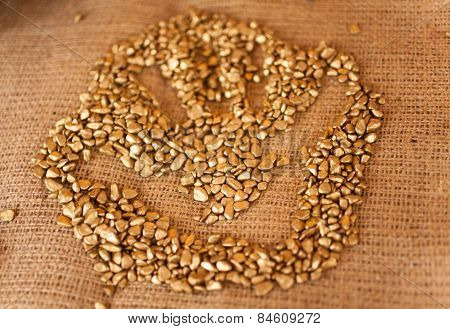 Handprint On Pile Of Golden Nuggets Lying On Table