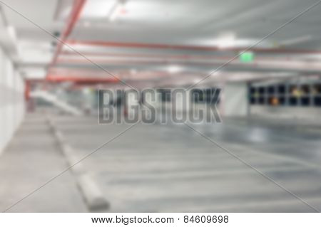 Abstract Blur Background Of Vacant Or Empty Space Of Car Parking Lot At Night, Shallow Depth Of Focu