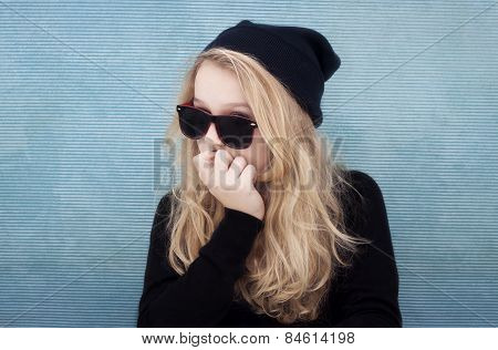 Teenage Girl With Hat Sunglasses And Attitude