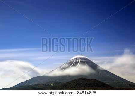 A long exposure of cloud moving around Mount Fuji in Japan.