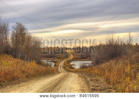 Winding dirt road in a valley